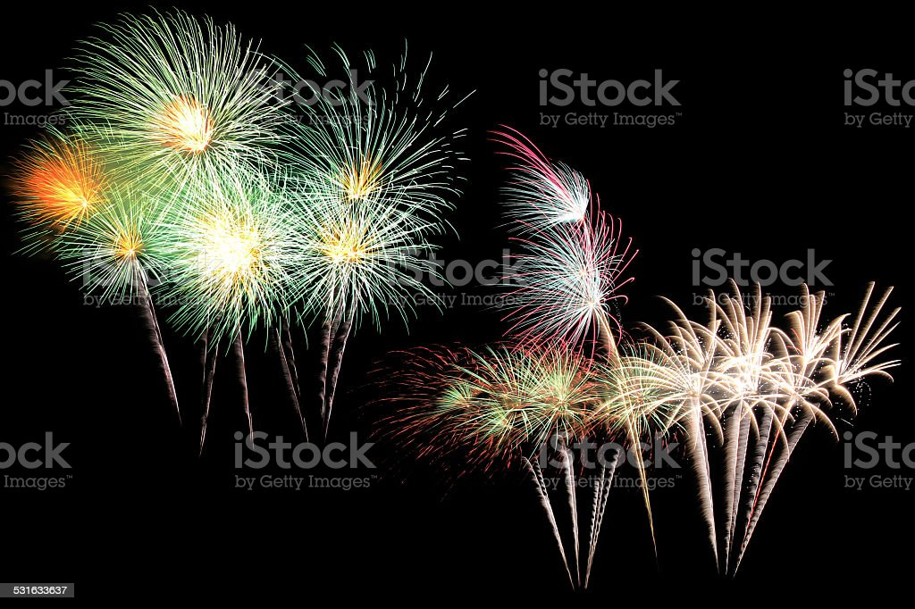 Colorful fireworks isolated on black background stock photo