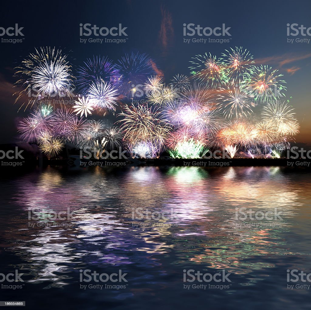 Colorful fireworks of various colors over evening sky stock photo