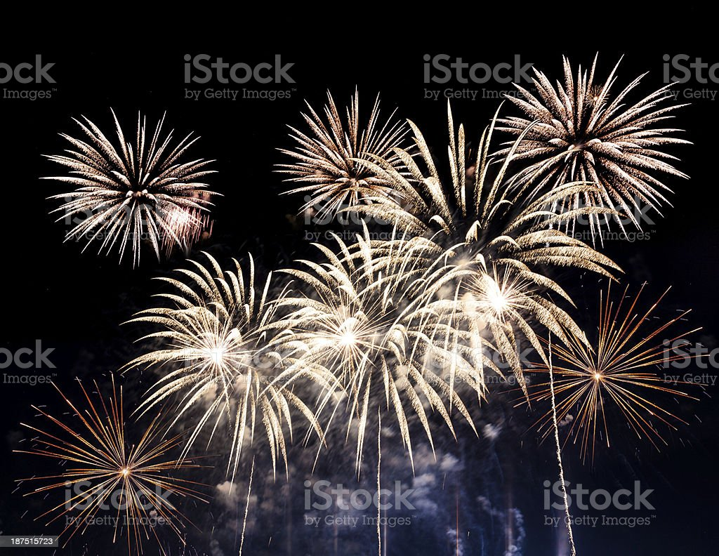 Colorful fireworks of various colors over night sky stock photo