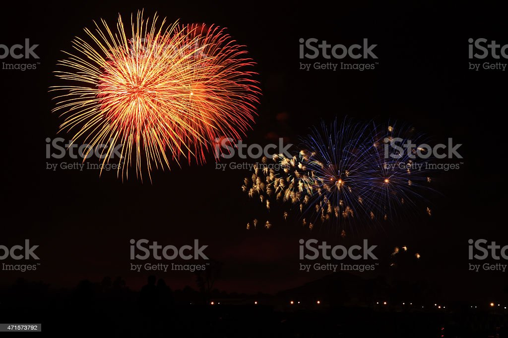 Colorful fireworks over dark sky royalty-free stock photo