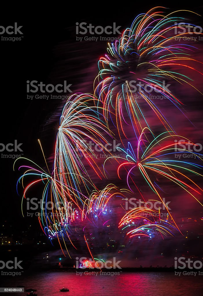 Colorful Fireworks over sea stock photo