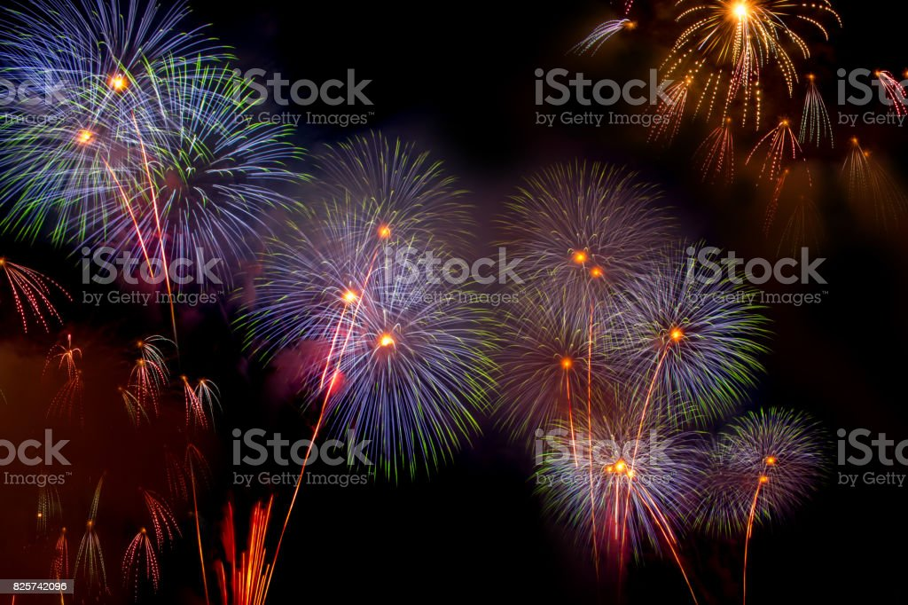 Colorful fireworks over the night sky stock photo