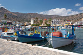 Colorful fishing boats in the small harbor of Elounda