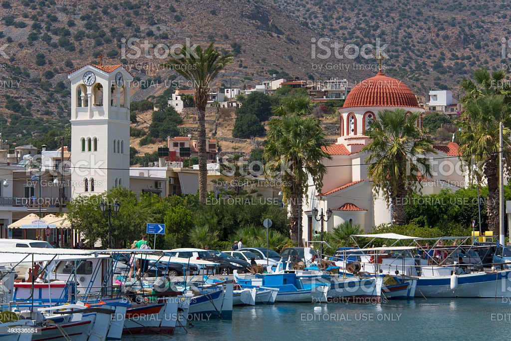 Colorful fishing boats in the small harbor of Elounda stock photo