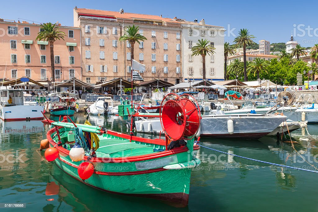 Colorful fishing boats moored in old port stock photo