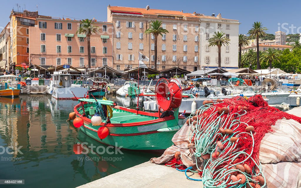 Colorful fishing net laying in port of Ajaccio stock photo