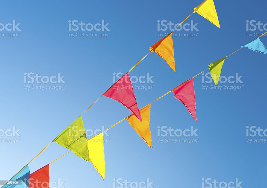 Colorful flags hanging on a string stock photo