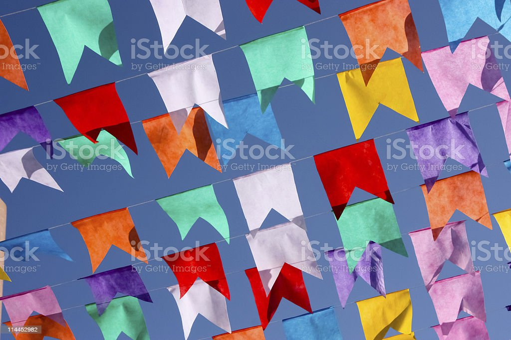 Colorful flags hanging on wires  stock photo