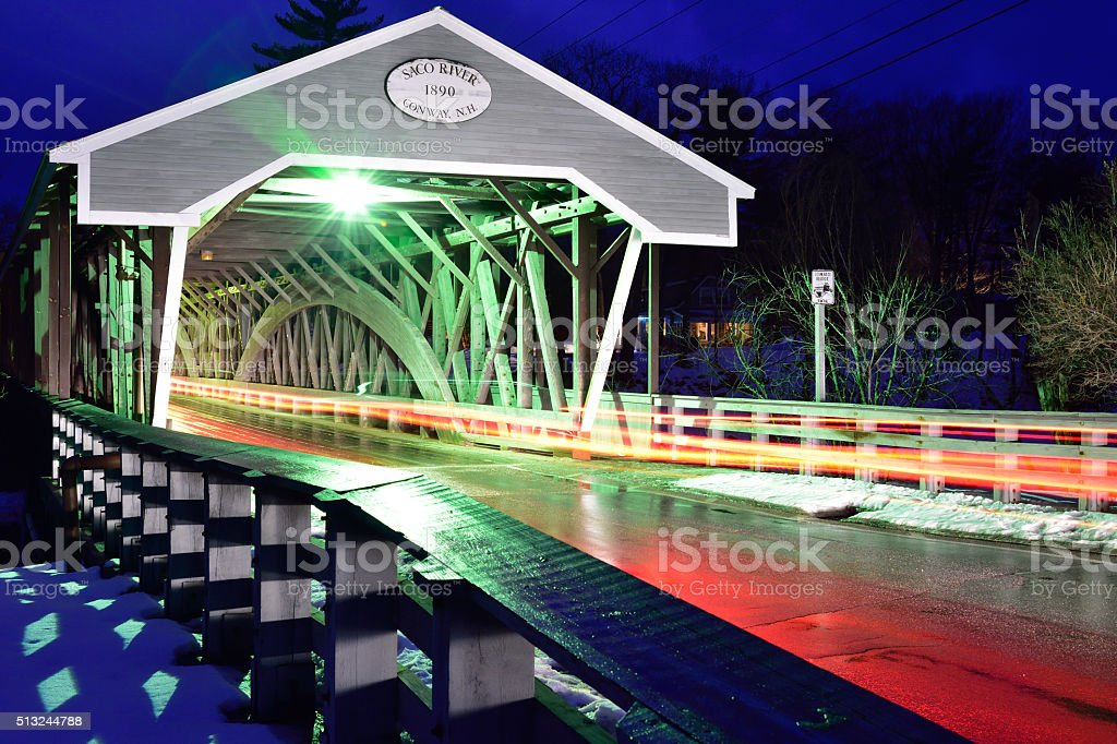 Colorful Flourescent Lights Accent Covered Bridge Over Saco River stock photo