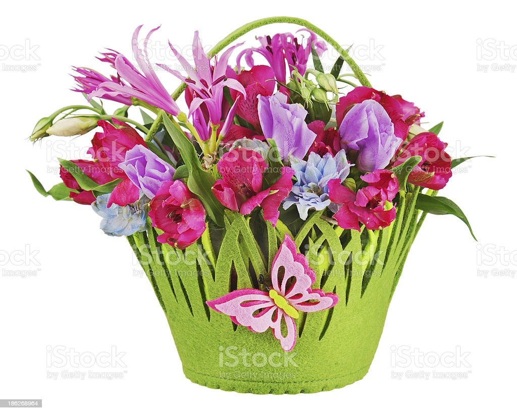 Colorful flower bouquet arrangement centerpiece in baby basket i stock photo