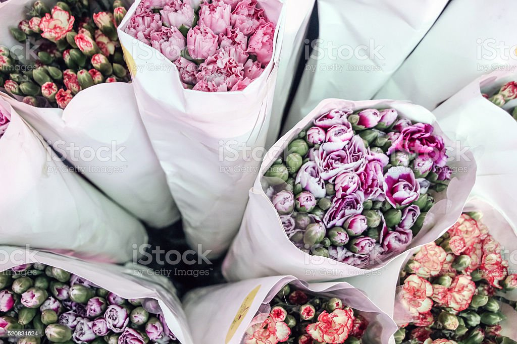 colorful flower bouquets warped by white paper stock photo