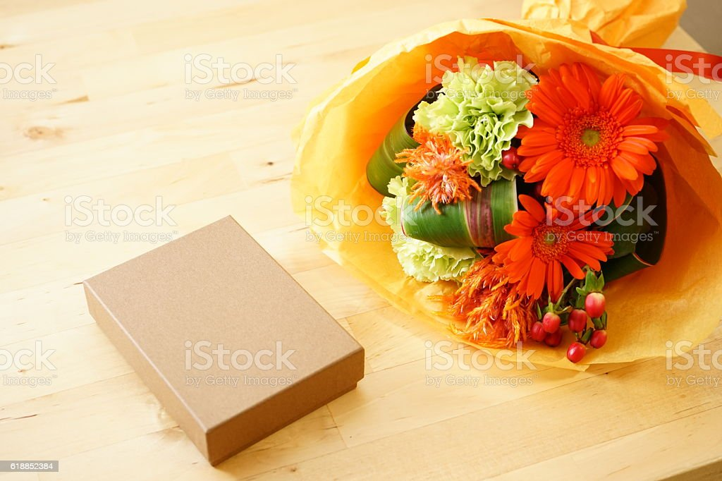 Colorful flowers and gifts on the table