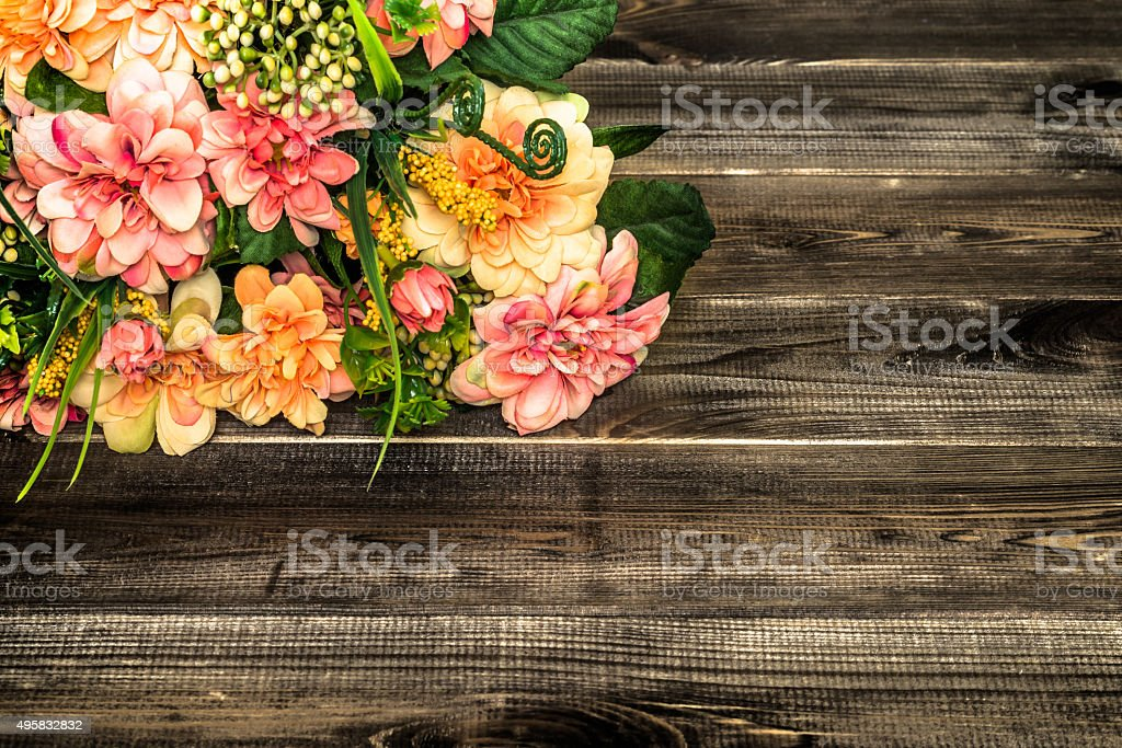Colorful flowers bouquet on wood background. Flowers backgrounds. stock photo