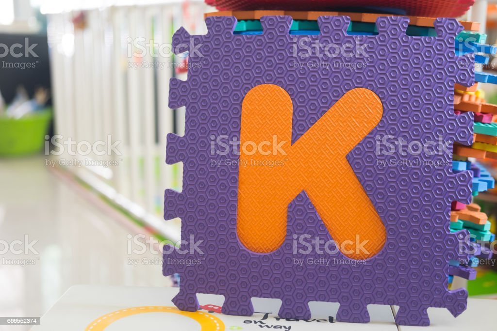 Colorful foam puzzle letters, education concept to learn English alphabet stock photo
