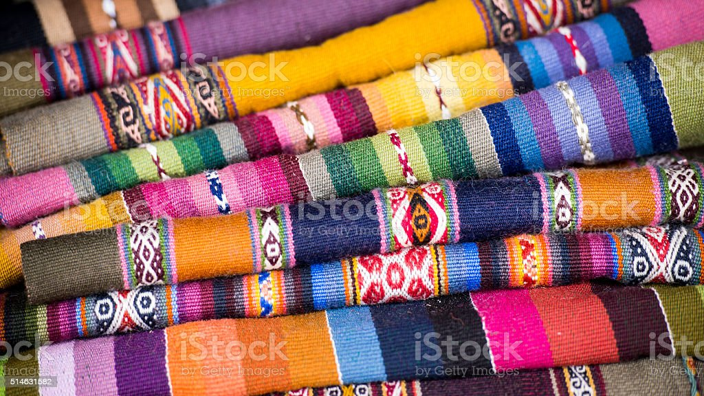 Colorful Folded Andean Woven Wool Textiles stock photo