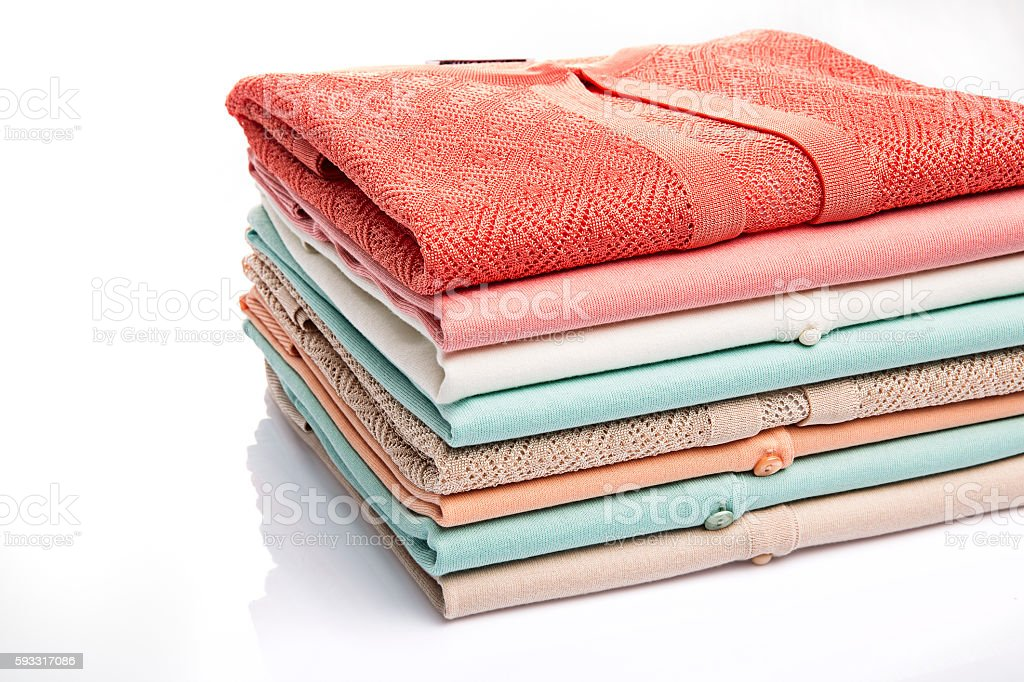 colorful folded clothes stock photo