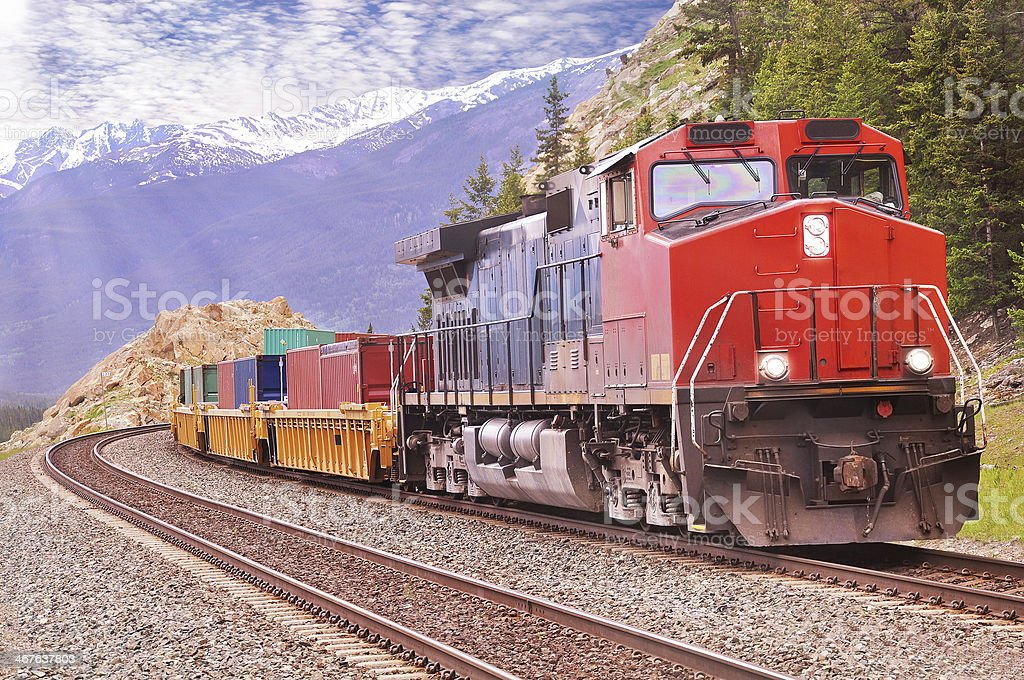 A colorful freight train on a nice day stock photo