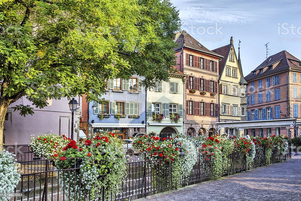 Colorful french houses wiht wlowers in Colmar stock photo