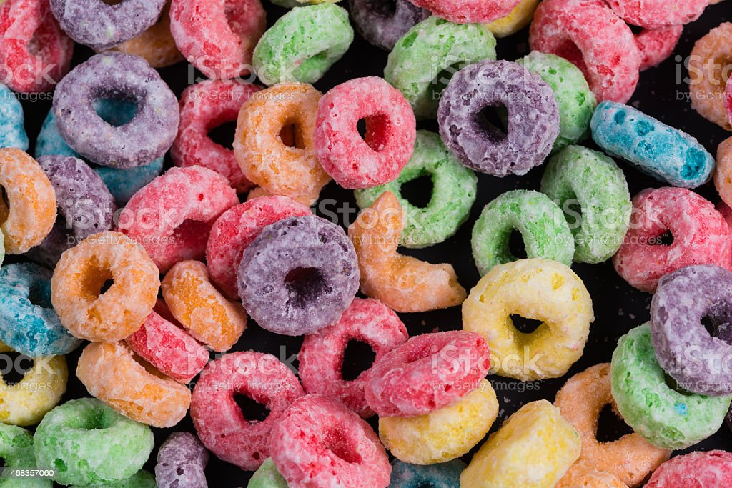 Colorful Fruit O shaped cereal on a black background stock photo