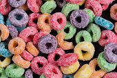 Colorful Fruit O shaped cereal on a black background