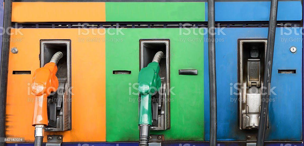 Colorful fuel oil gasoline dispenser at petrol filling station stock photo