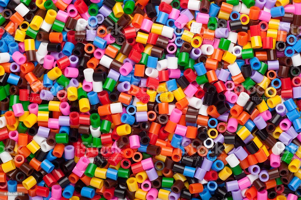 Colorful fusible plastic beads stock photo