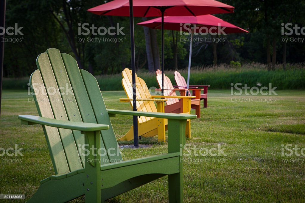 Colorful garden furniture lined up in a row. royalty-free stock photo