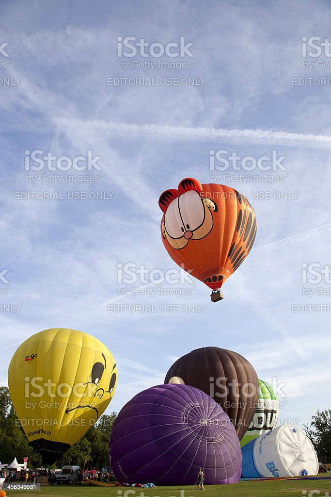 Colorful Garfield and other air balloons taking off royalty-free stock photo