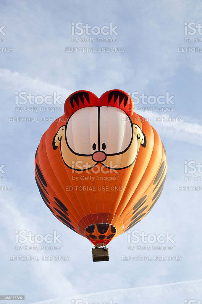 Colorful Garfield balloon taking off stock photo