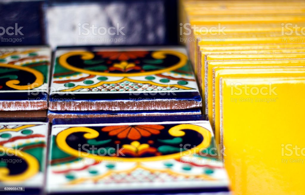 Colorful Geometric and Yellow Mexican Tiles Lined Up stock photo