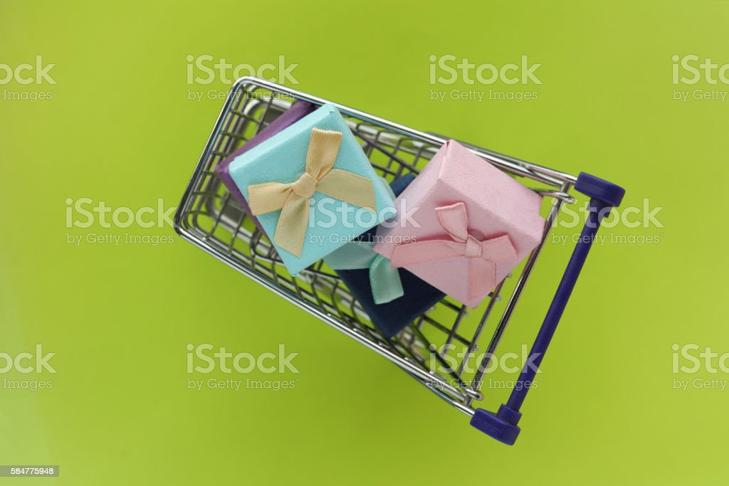 Colorful gift boxes in steel shopping cart stock photo