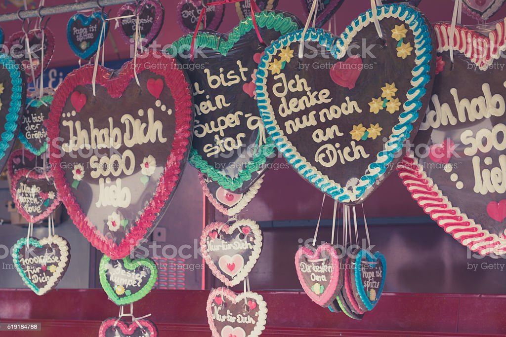 colorful gingerbread hearts at fair in germany stock photo