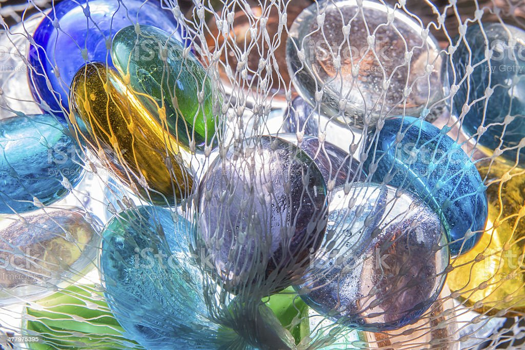 Colorful glass beads in net royalty-free stock photo
