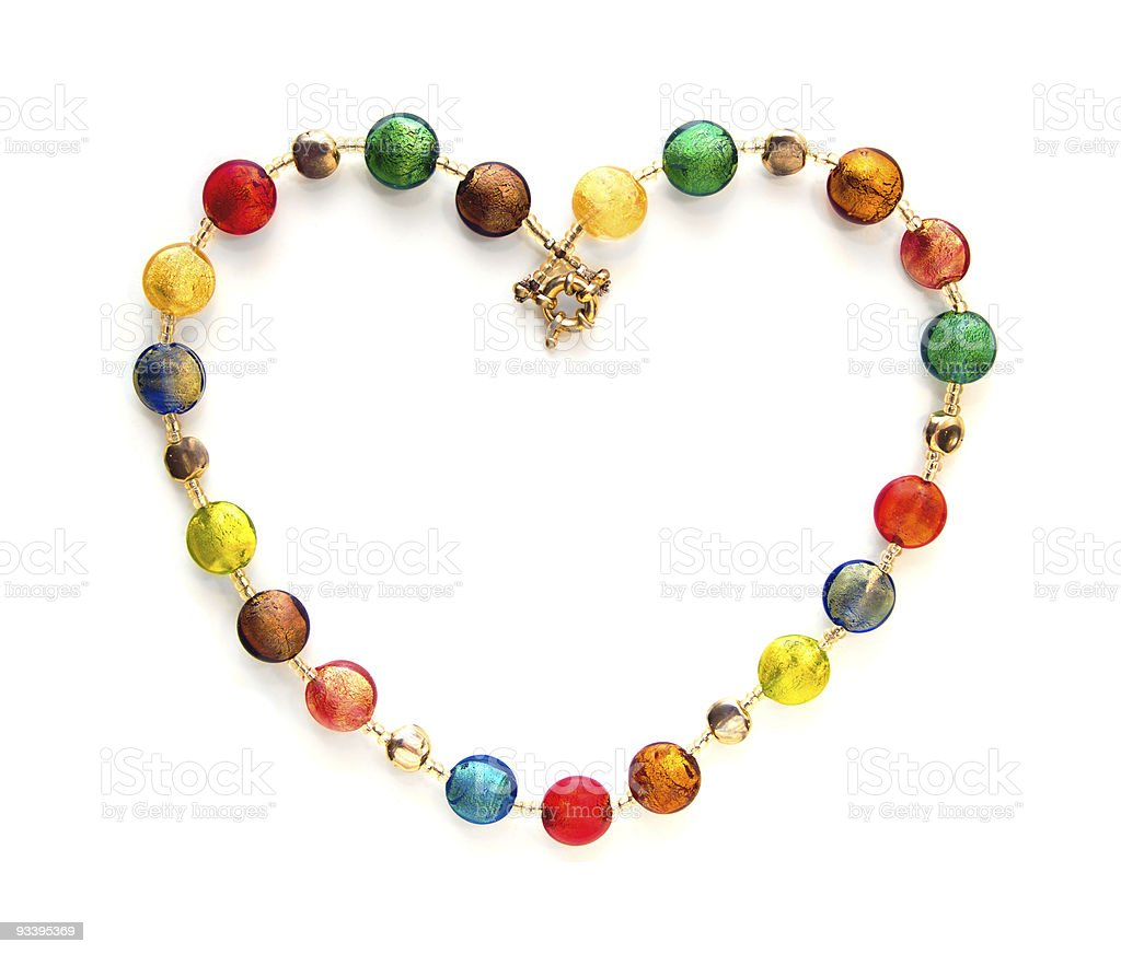 Colorful glass beads shaped as heart stock photo
