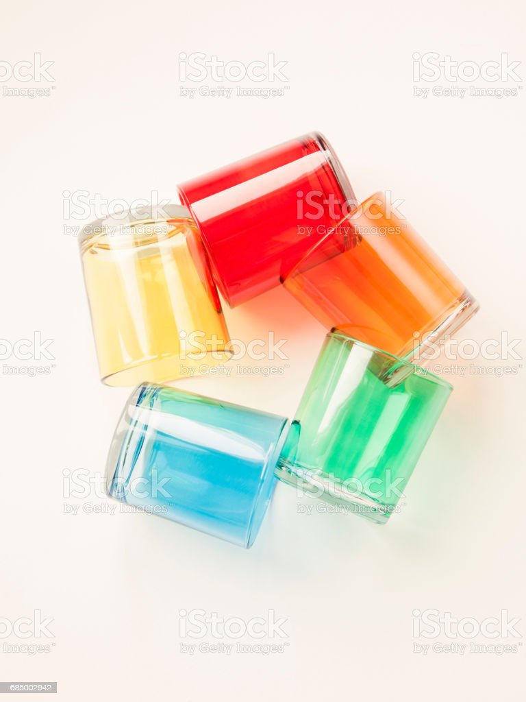 Colorful glasses on white background. stock photo