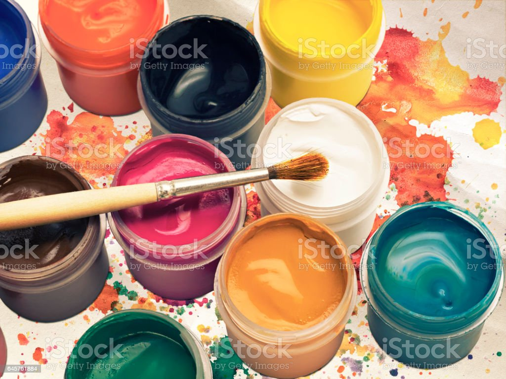 colorful gouache paint and brush on background stock photo