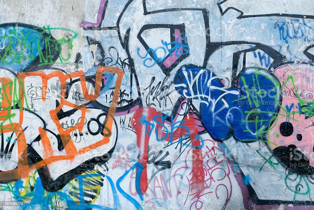 Colorful graffiti on a cement wall stock photo