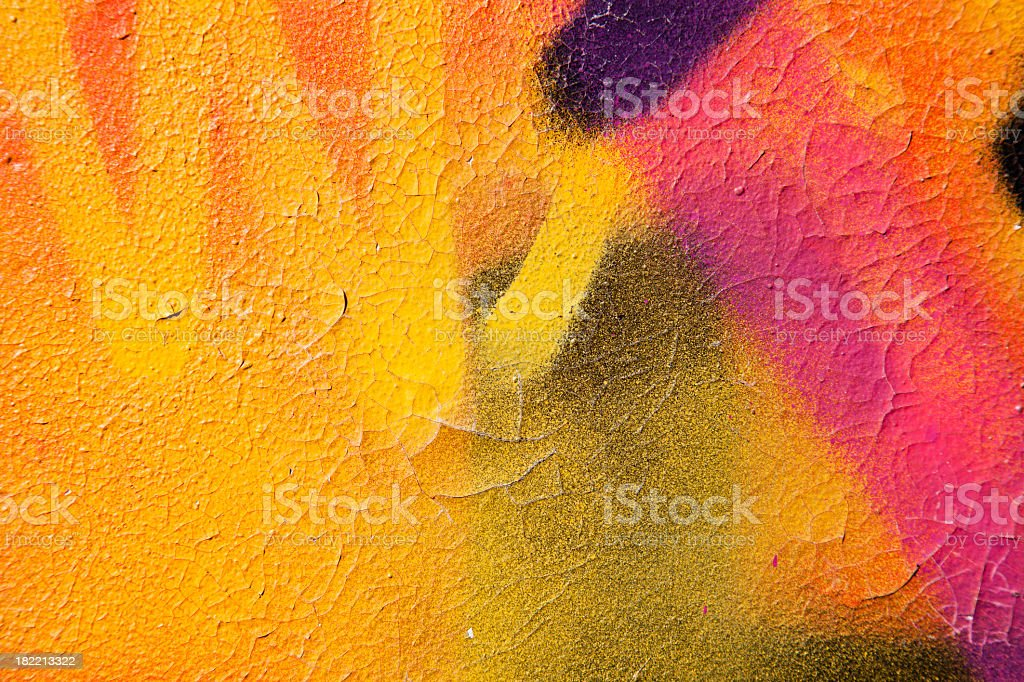 Colorful graffiti over a cracked surface stock photo