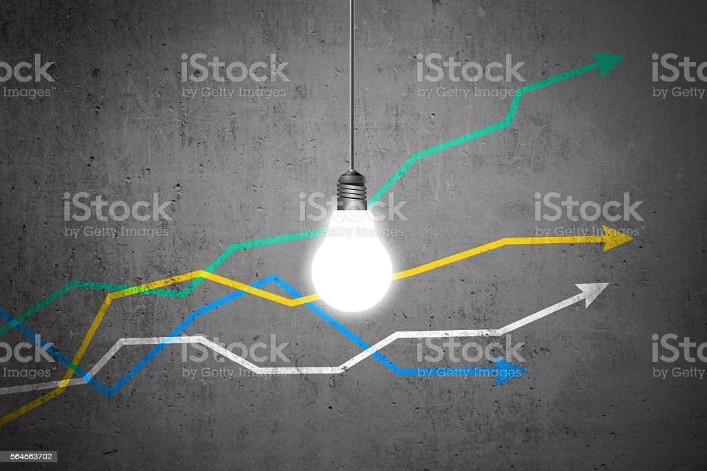 Colorful graph lines with light bulb on dirty wall stock photo