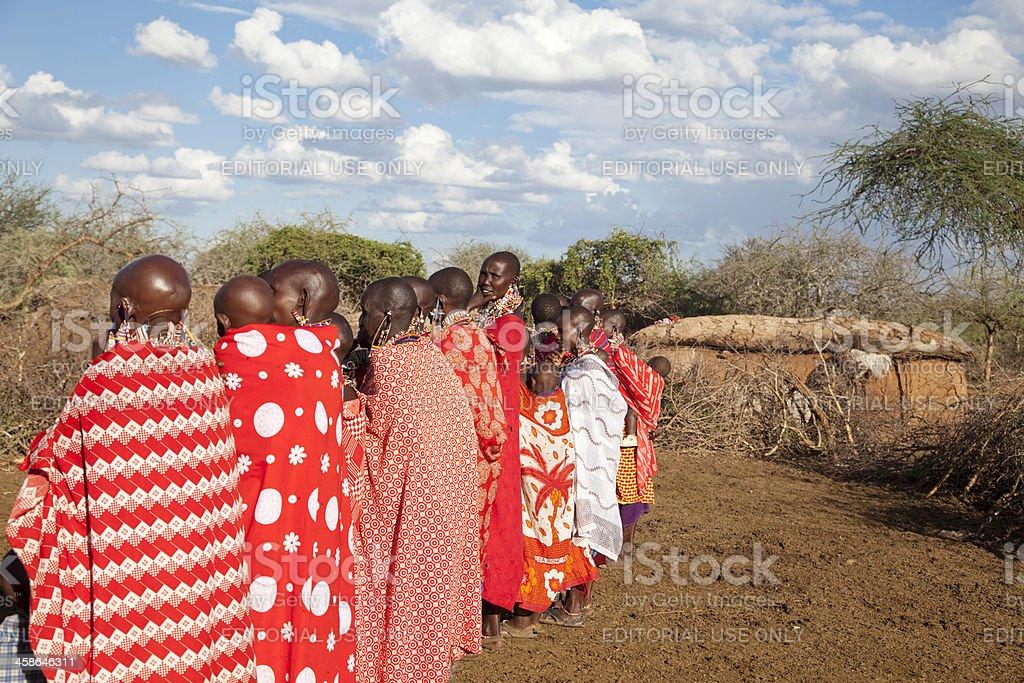 Colorful group of maasai women in village, Kenya. stock photo
