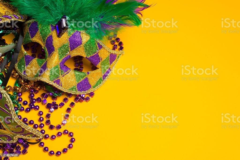 Colorful group of Mardi Gras or venetian mask on yellow stock photo