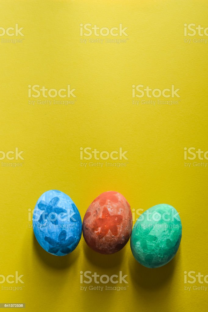 colorful grunge easter eggs on yellow paper background with space for copy stock photo