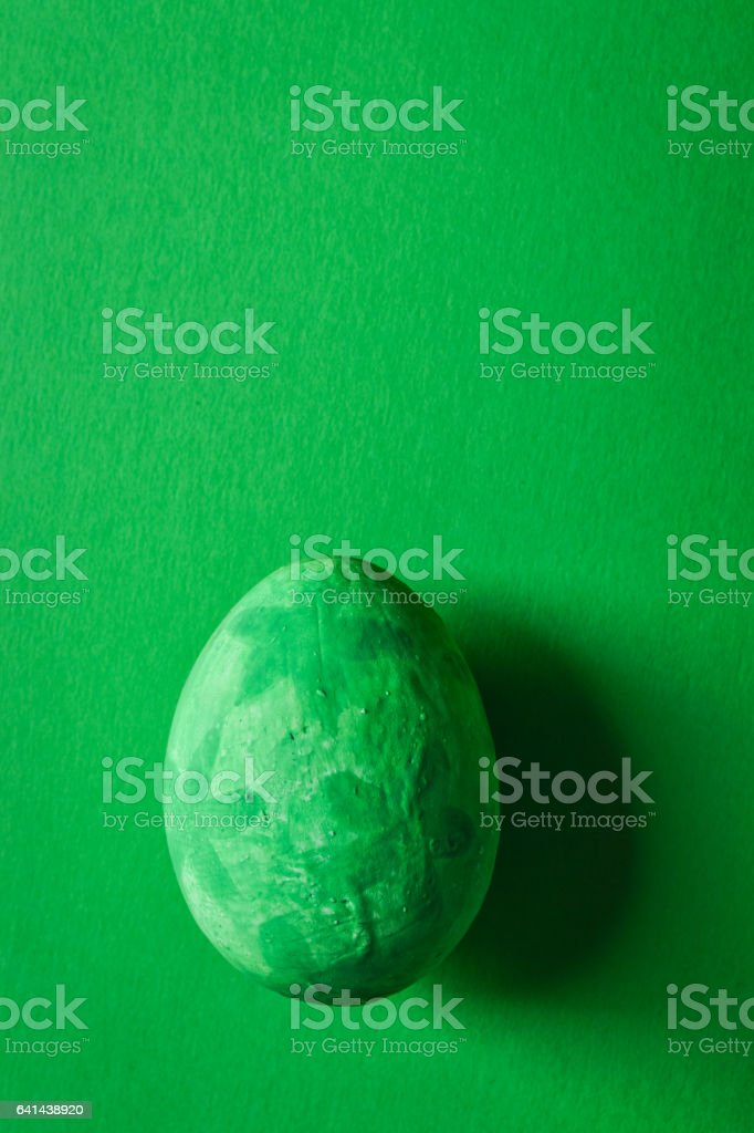 colorful grunge green easter eggs on green paper background stock photo