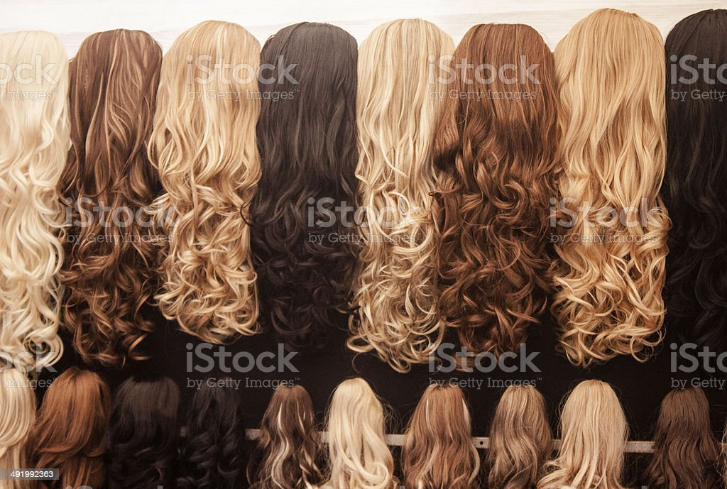 Colorful hair pieces and wings stock photo