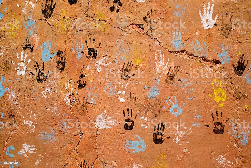 colorful hand prints on brown wall royalty-free stock photo