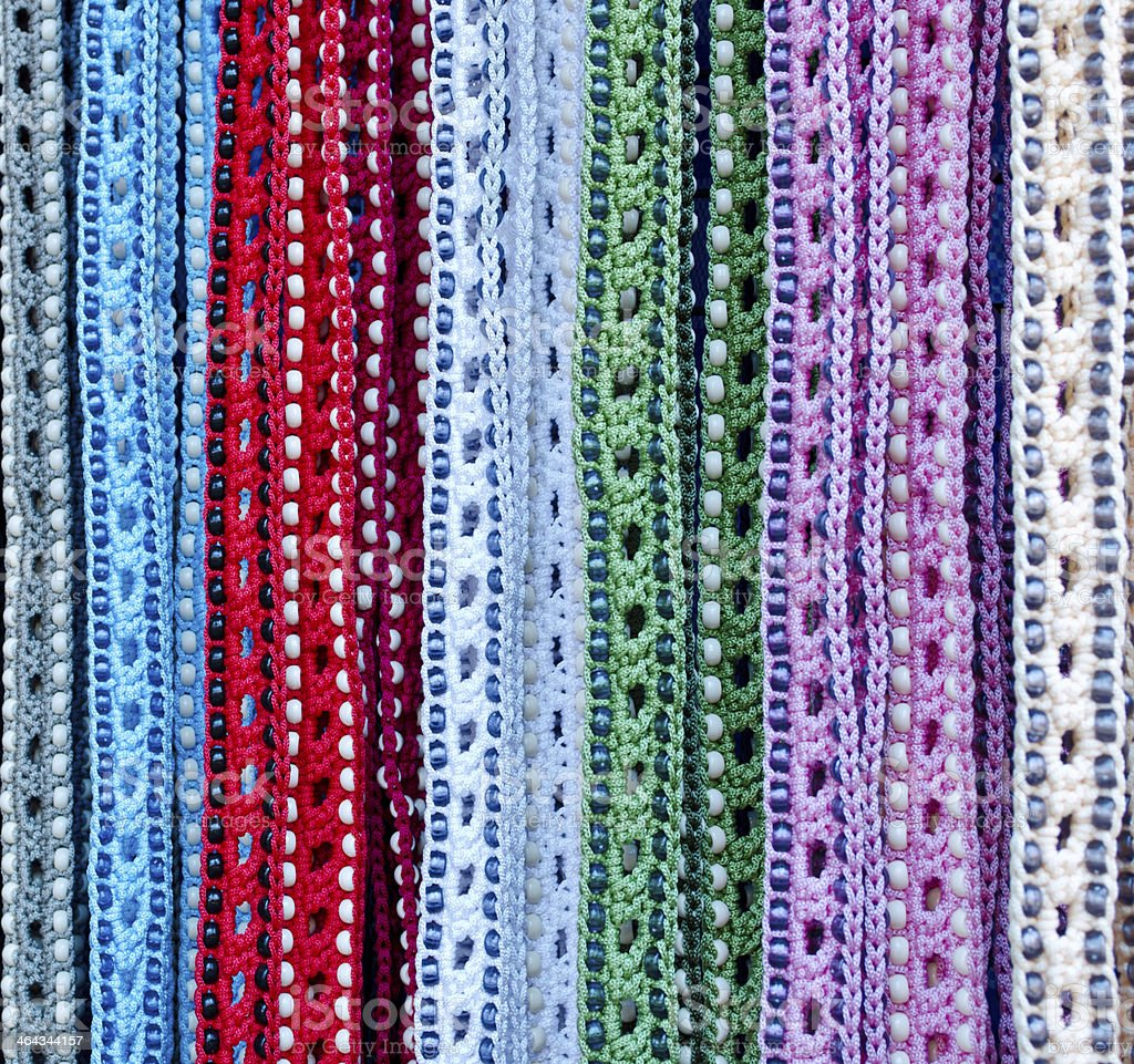 Colorful handcrafted belts with beads stock photo