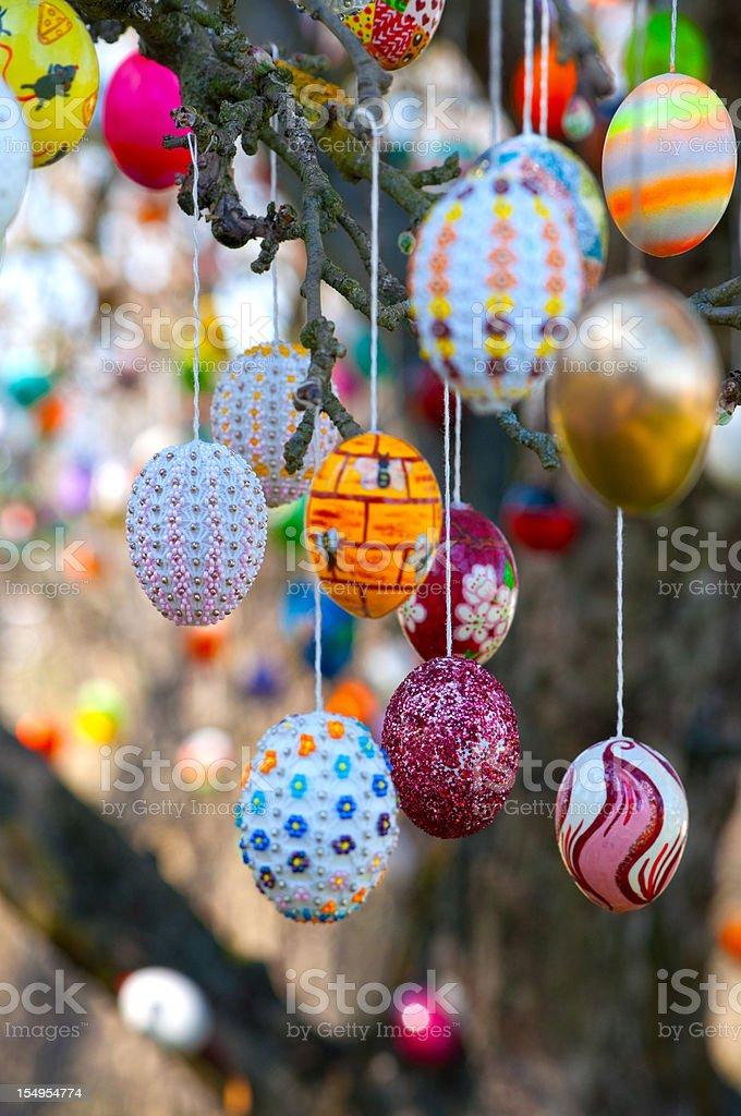 Colorful handmade Eastereggs on an apple tree- Eierbaum in Saalfeld stock photo