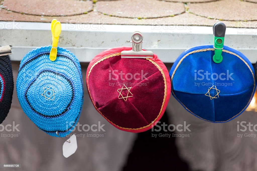 Colorful handmade Jewish caps with Star of David , Kippah, sold  in the street shop before entering the Klausen Synagogue, Prague, Czech Republic stock photo