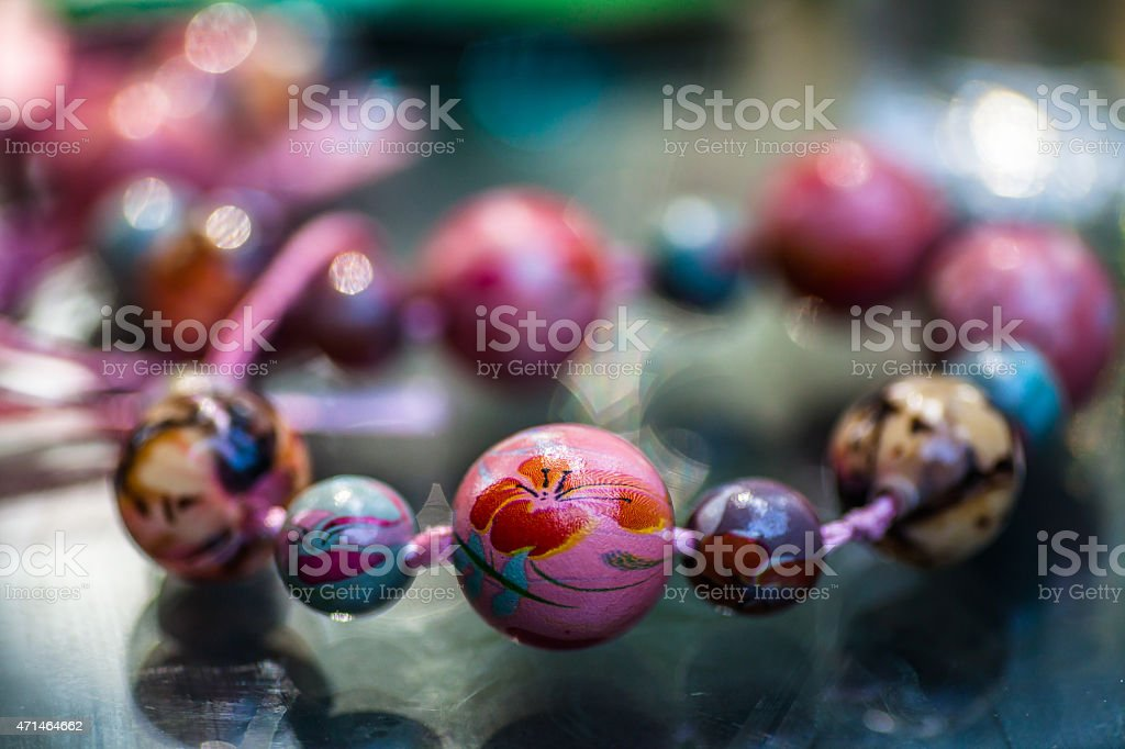 Colorful handmade necklace on the table stock photo