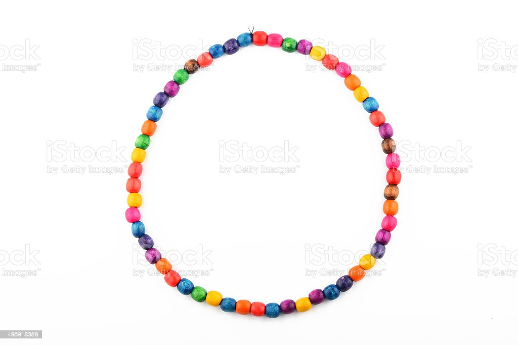 Colorful handmade wooden painted beads necklace isolated on whit royalty-free stock photo
